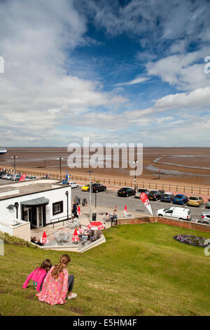 UK, England, Lincolnshire, Cleethorpes, Pier Gardens children playing on grassy slope above the promenade - Stock Photo