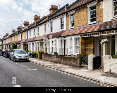 Row of typical terraced Victorian cottages in suburban London - Twickenham, UK - Stock Photo