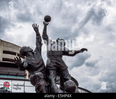 Twickenham Rugby Union stadium and bronze sculpture of Rugby players leaping for a rugby ball, London, England, - Stock Photo