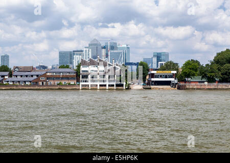 London skyline from Thames river - Canary Wharf Banking district, Isle of Dogs, Poplar rowing club. apartment buildings - Stock Photo