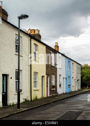 Typical Victorian Terraced cottages with different coloured paint in suburban London, UK - Stock Photo