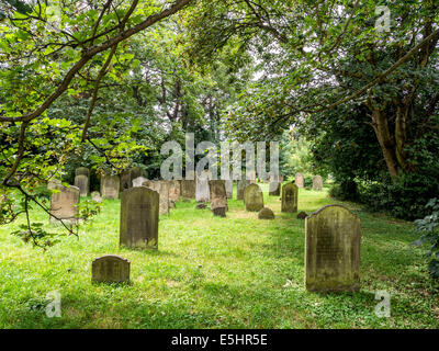 Old Cemetery and graveyard with weathered tombstones in a leafy burial ground - Twickenham, London, UK - Stock Photo