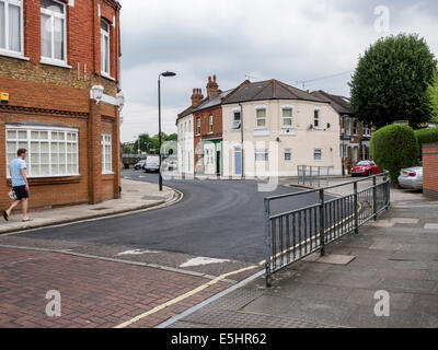 Suburbia, Amyand Park Road, Twickenham, Greater London, UK - man walking in suburban street - Stock Photo