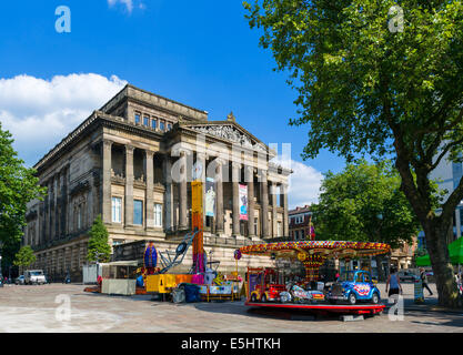 Fairground rides in front of the Harris Museum and Art Gallery, Market Square, Preston, Lancashire, UK - Stock Photo