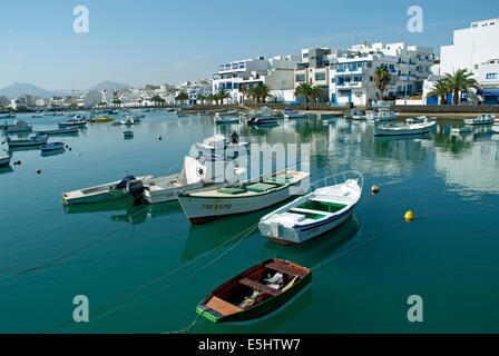 Boats and residential houses at Arrecife - El Charco Lanzarote Canary Islands Spain - Stock Photo