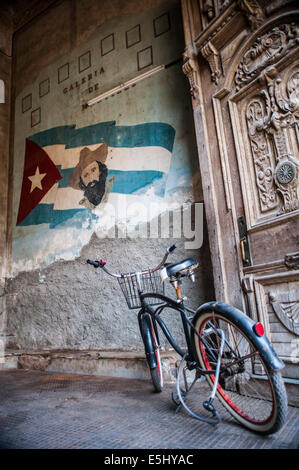 A bicycle at the entrance of La Guarida Restaurant in Havana Cuba where the famous movie 'Strawberries and Chocolate' - Stock Photo