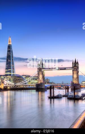 UK, England, London, Wapping, Tower Bridge, City Hall and the Shard at dusk - Stock Photo