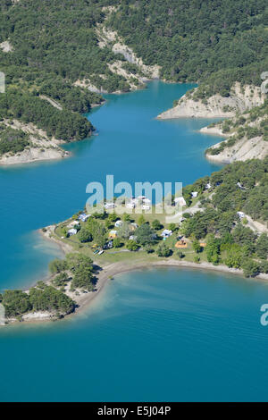 CAMPGROUND IN AN IDYLLIC SETTING (aerial view). Lake Serre-Ponçon, Hautes-Alpes, France. - Stock Photo