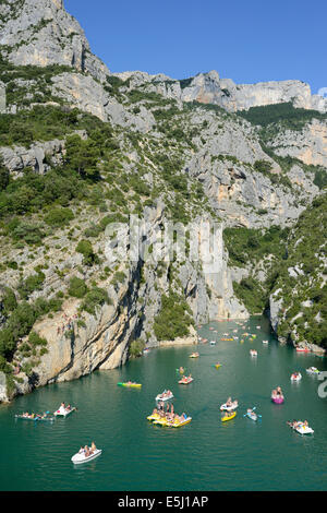 SCORES OF BOATERS IN A DEEP LIMESTONE CANYON. Gorges du Verdon, Lake Sainte-Croix, Alpes-de-Haute-Provence & Var, - Stock Photo