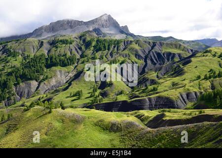 GRASSY HILLSIDE AND DARK RAVINES. Col des Champs, Mercantour National Park, Alpes-de-Haute-Provence & Alpes-Maritimes, - Stock Photo
