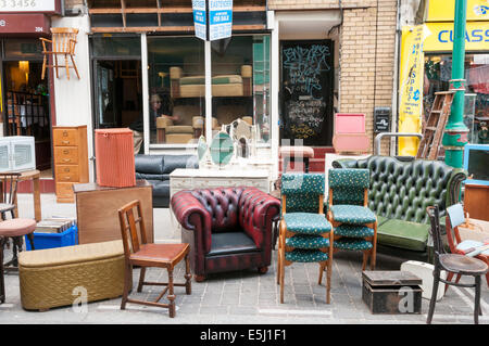 Used second hand furniture on sale on a UK high street Stock