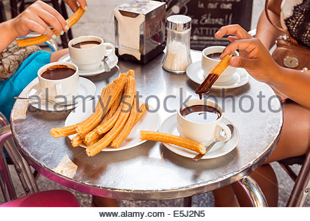 Churros and hot chocolate drinks at the Chocolateria San Gines, Madrid, Spain - Stock Photo