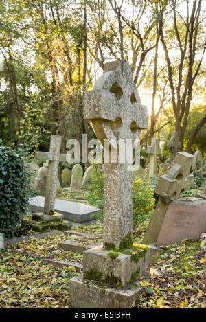 Old tombstones in Highgate Cemetery, London, England, UK - Stock Photo
