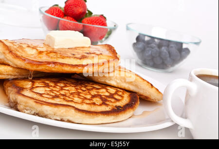 Stack of Pancakes with Butter, Syrup and Berries - Stock Photo