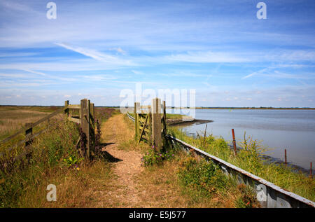 A view of the Angles Way long distance footpath running by Breydon Water, near Great Yarmouth, Norfolk, England, - Stock Photo