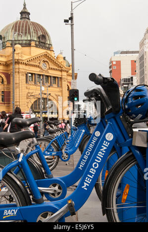 Melbourne Bikes for hire in front of Flinders Street Station Melbourne Australia - Stock Photo