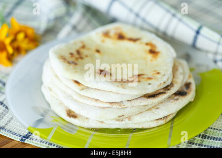 homemade fresh baked pitas on the table - Stock Photo