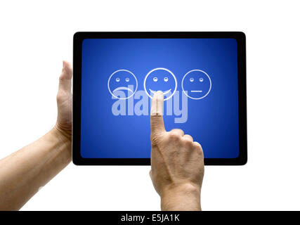 Hand touching screen with customer service evaluation form on a  tablet - Stock Photo
