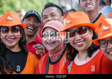 Netherlands, Amsterdam, World Cup Football Brazil 2014. Museumplein. Inhabitants from Indonesia supporting the Dutch - Stock Photo