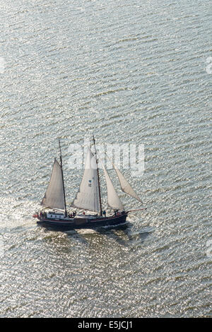 The Netherlands, near Urk, Lake called IJsselmeer. Traditional cargo sailing ships, now tourist cruises. Aerial - Stock Photo