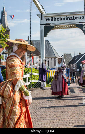 Netherlands, Marken, People dressed in costume from 18th Century from area called Zaanstreek - Stock Photo