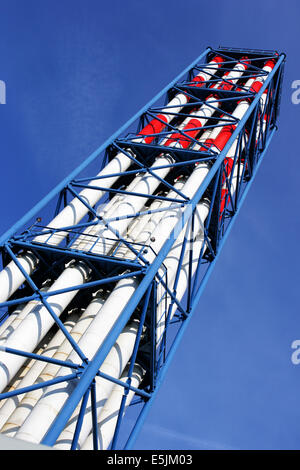 Tall chimneys close-up against blue sky - Stock Photo