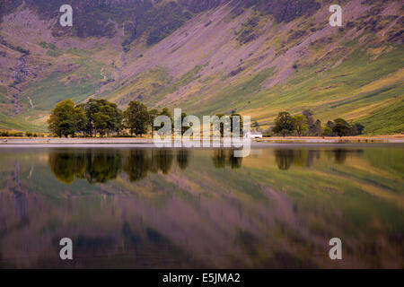 Pre-dawn reflections on Buttermere Lake, Cumbria, Lake District, England - Stock Photo