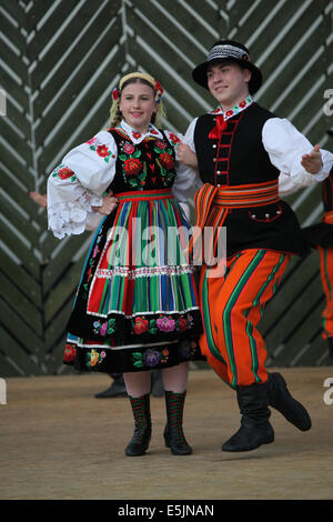 A couple from Polish folklore ensemble LESZCZYNIACY from Swidnik (Lublin Province) dancing at Cassovia folklore - Stock Photo