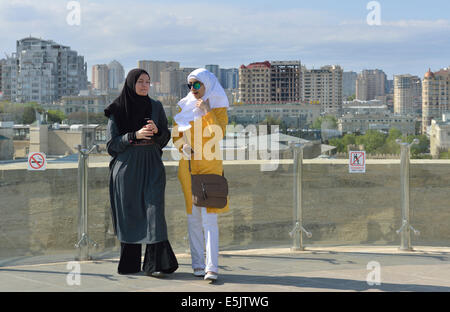 Two women on viewing platform of the Maiden Tower, Old City, Baku, Azerbaijan - Stock Photo
