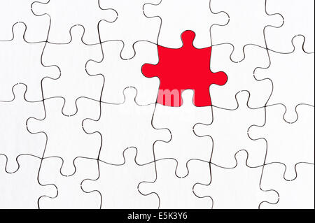 blank white jigsaw with one red piece stand out from the crowd concept - Stock Photo
