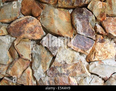 Old stone wall background of natural objects. - Stock Photo