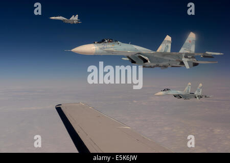 Russian Federation Air Force Su-27 Sukhoi fighter aircraft intercept a simulated hijacked aircraft entering Russian - Stock Photo