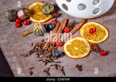 Chinese green tea and fragrant spices shot close-up in studio - Stock Photo