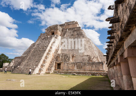 Stairs on the back side of the Pyramid of the Magician. Steep stairs lead up to the ceremonial temple chambers high - Stock Photo