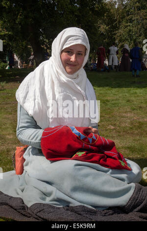 Beeston, Cheshire, UK 3rd August, 2014.  Rebecca Ferguson, embroidering at the Medieval Knights Tournament held - Stock Photo