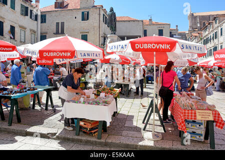 Market place stall holders and shoppers - Stock Photo