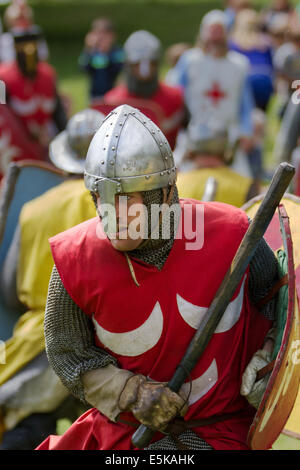 Beeston, Cheshire, UK 3rd August, 2014.  Helmeted armed re-enactors with shields, at the Medieval Knights Tournament - Stock Photo