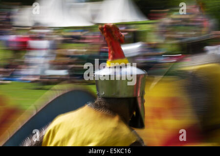 Beeston, Cheshire, UK 3rd August, 2014.  Helmeted armed re-enactors with shields, at the Medieval armoured Knights - Stock Photo