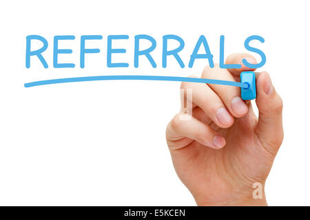Hand writing Referrals with blue marker on transparent wipe board. - Stock Photo