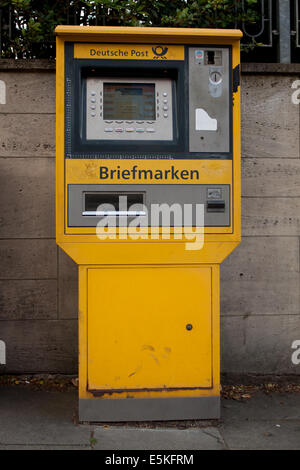 Machine selling stamps on a street in city center in Hamburg , Germany - Stock Photo