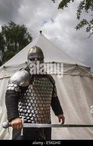 Armed swordsman in full military armour with chain mail, sword, and helmet at Beeston Castle in Cheshire, England. - Stock Photo