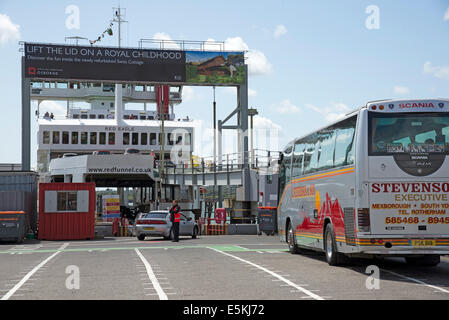 Loading a roro car passenger ferry in Southampton UK Red Funnel company vessel - Stock Photo
