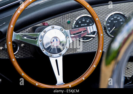 Steering wheel and dashboard of a Shelby Cobra 427. - Stock Photo