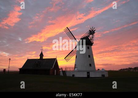 Lytham windmill in Lancashire with dramatic sunset - Stock Photo