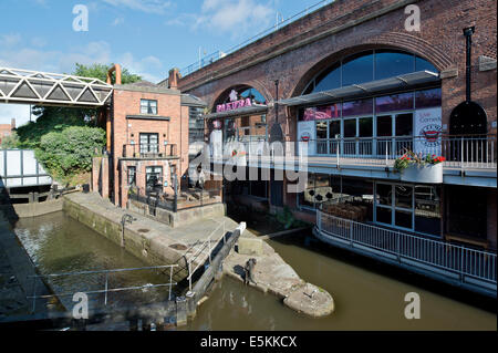 Sakura and The Comedy Store, and another neighbouring bar in the summer sunshine at Deansgate Locks in Manchester. - Stock Photo