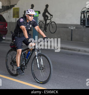 Ottawa Police Bicycle Patrol. An Ottawa policeman on bicycle patrol on Preston Street in Ottawa. - Stock Photo