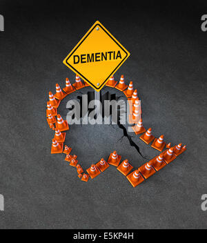 Dementia handicap concept as a group of three dimensional traffic cones shaped as a human head with a warning road - Stock Photo