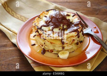 pancakes with banana and chocolate, food closeup - Stock Photo