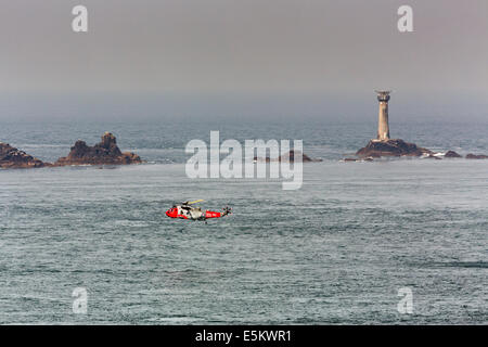 Air Sea Rescue; Longships Lighthouse; Helicopter; Land's End; Cornwall; UK - Stock Photo