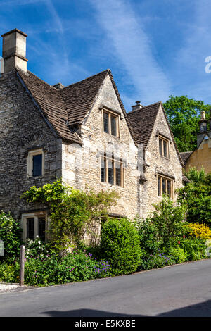 Cotswold stone houses in the village of Castle Combe in Wiltshire. - Stock Photo